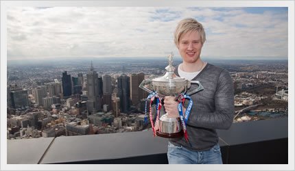 Neil Robertson with World Championship trophy on top on Eureka Tower